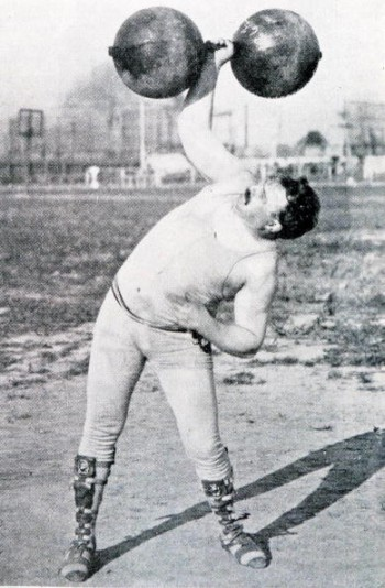1904 Olympic Games, St, Louis, USA, Weightlifting,USA's Frederick Winters in action to win the silver medal in the Dumb-bell event (Photo by Popperfoto/Getty Images)