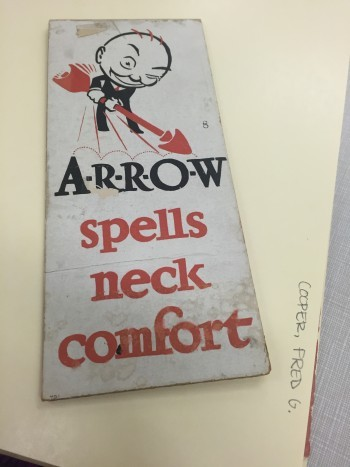 Image of an illustration by Fred G. Cooper from the Walt Reed Illustration Archive. Illustration shows a drawing of a bald man in a suit with an overlarge arrow in hand and reads: A-R-R-O-W spells nect comfort.