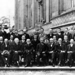 The Fifth Solvay Conference, on Electrons and Photons. Arthur Holly Compton is seated in the second row, fourth from the right, directly behind Albert Einstein and Paul Langevin. Photo credit: Wikipedia Commons.