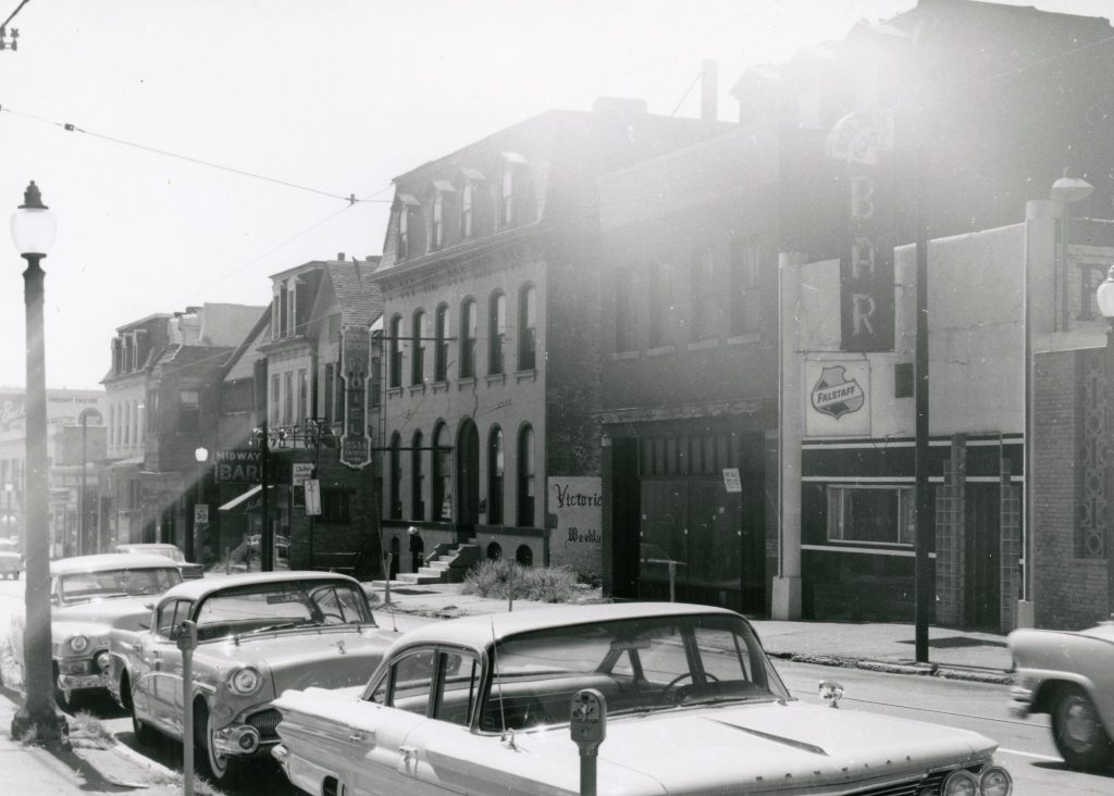 The south side of the 3500 block of Olive in the early 1960s. Several popular lesbian and gay hangouts are visible: Shelley's Midway Bar, Act IV Coffeehouse, and the Golden Gate Bar (left to right). Another gay bar, the Onyx Room, is out of the frame to the right. All of these buildings were later demolished. Image courtesy of the Missouri History Museum.