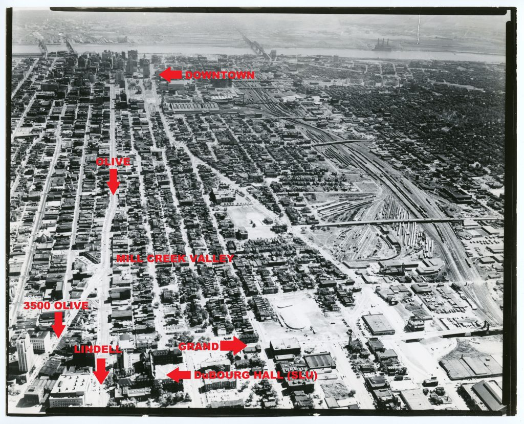 Image 4: An aerial view of the eastern half of St. Louis's Central Corridor, probably taken in the late 1940s or early 1950s. The Continental Life Building and the 3500 block of Olive are visible in the lower left corner. This photograph illustrates how close the 3500 block of Olive was to the Mill Creek Valley. Image courtesy of the Missouri History Museum.