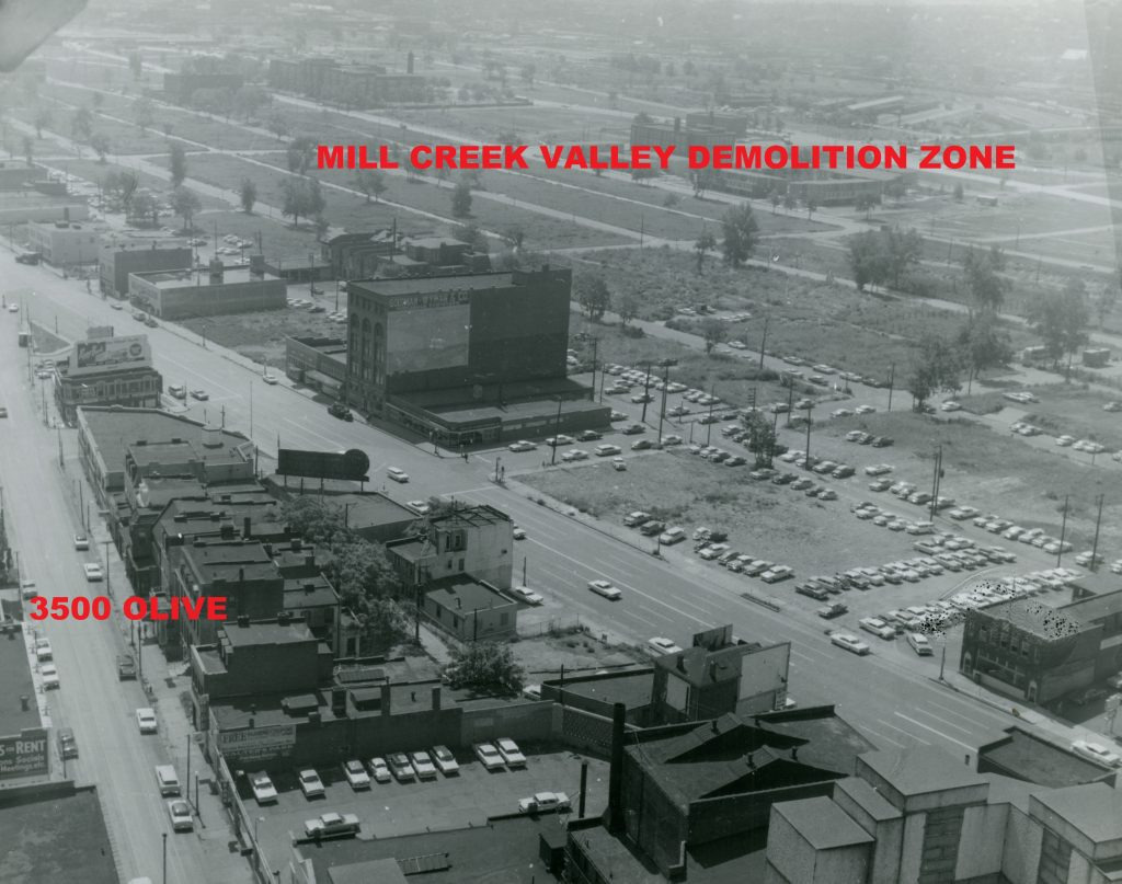 Image 7: An aerial view of the 3500 block of Olive and its environs in the early 1960s, taken from the Continental Life Building looking toward the southeast. The mostly empty, grass-covered lots in the upper-right portion of the photograph were part of the Mill Creek Valley slum clearance area. Image courtesy of the Missouri History Museum.