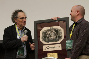 Gordon Quinn of Kartemquin Films receives the St. Louis International Film Festival's Lifetime Achievement Award from Brian Woodman, Curator of Film & Media at Washington University Libraries, on November 6, 2016.