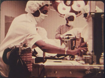 """A still from the film """"Code Blue"""" depicting doctors in a surgical theater operating room."""