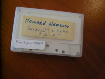 Photo of a cassette holding the recording of a reading by the poet Howard Nemerov from the River Styx Archive.