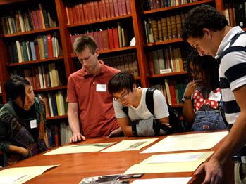 Students examining special collection items