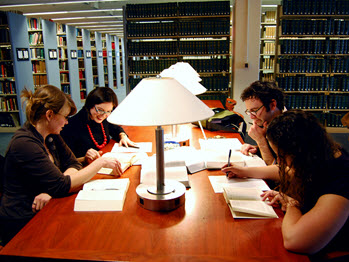 Students studying in the library at desks