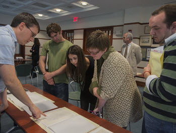 Library patrons working with a special collections librarian