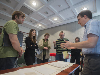 Students looking at special collections items