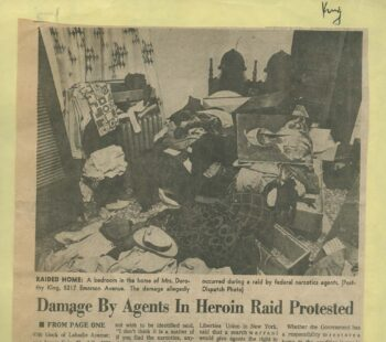 "photo in newspaper ""Damage by Agents in Heroin Raid Protested"""