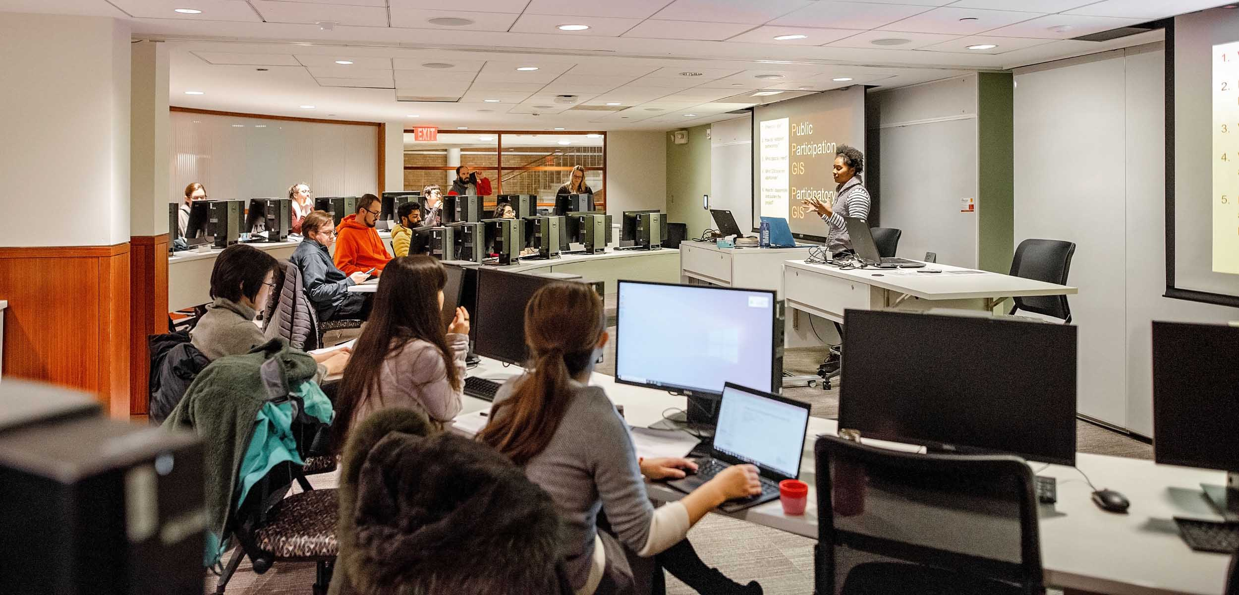 Students sit at computer terminals during an instructor-led Data Services GIS Workshop.