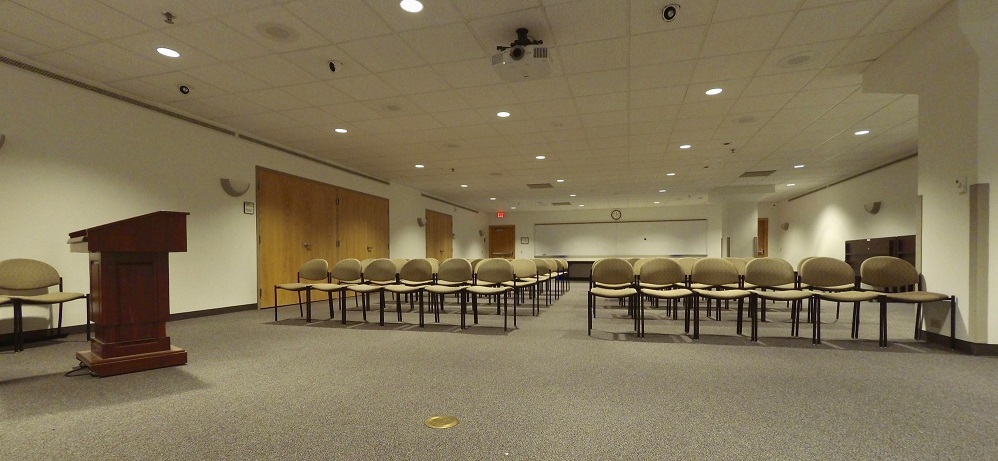 West Campus Conference Room AB with chairs arranged in two rows of chairs each six-across. The chairs are set to face a podium in a lecture style.