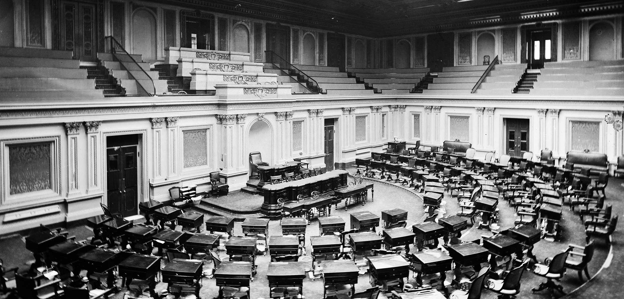 Black and white photo of the empty US Senate Chamber, circa 1873.
