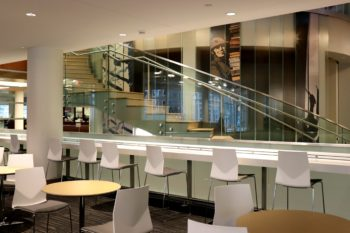 Newly renovated Whispers Cafe featuring bar counter study seating as well as smaller, paired tables, all done in a modern/contemporary style.