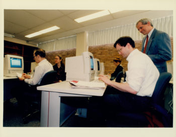 Users sitting in front of cathode-ray tube (CRT) monitors in Olin Library's then-new PC Lab circa the mid-90s.