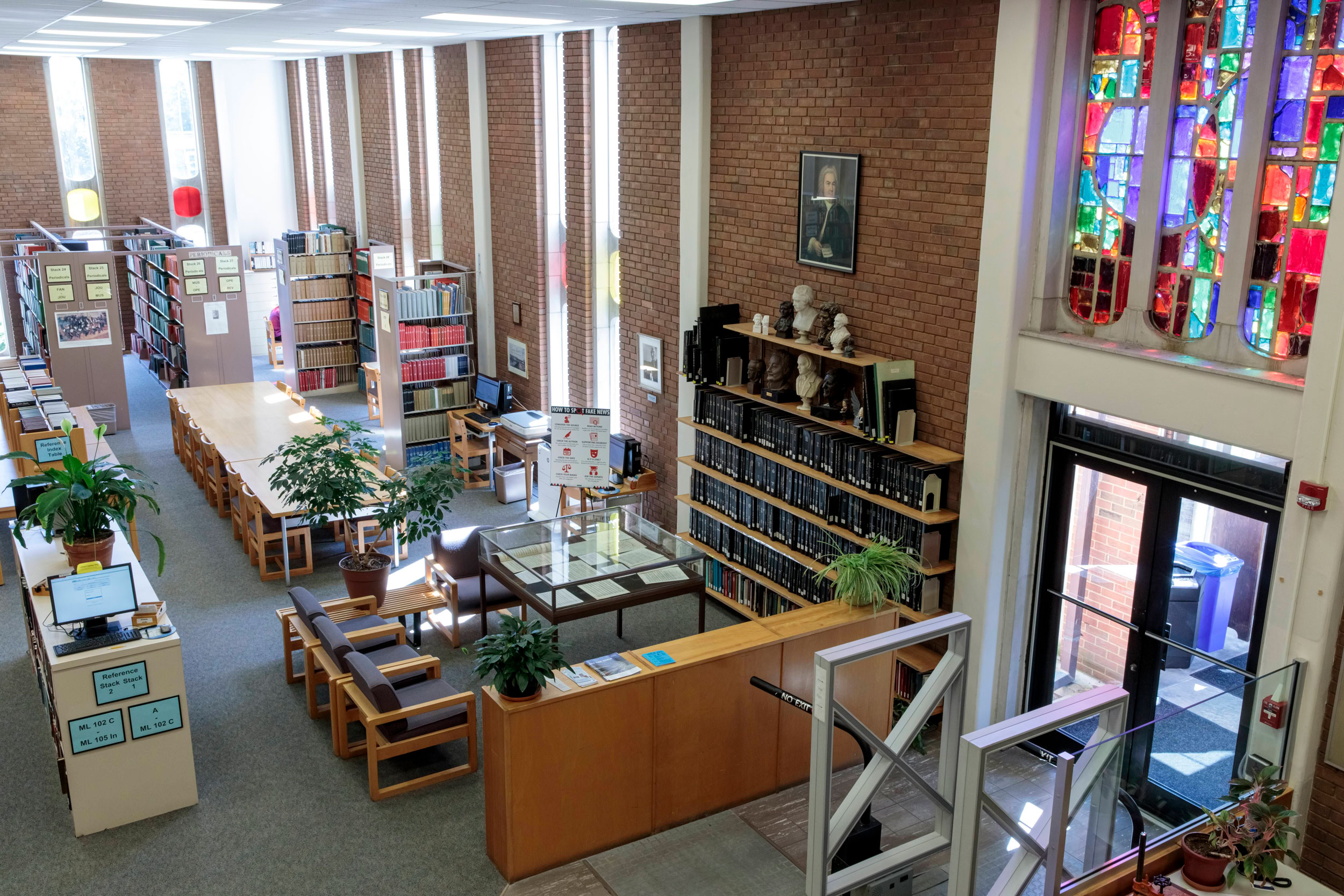 Interior shot of the Gaylord Music Library featuring the stained glass windows above an entrance.