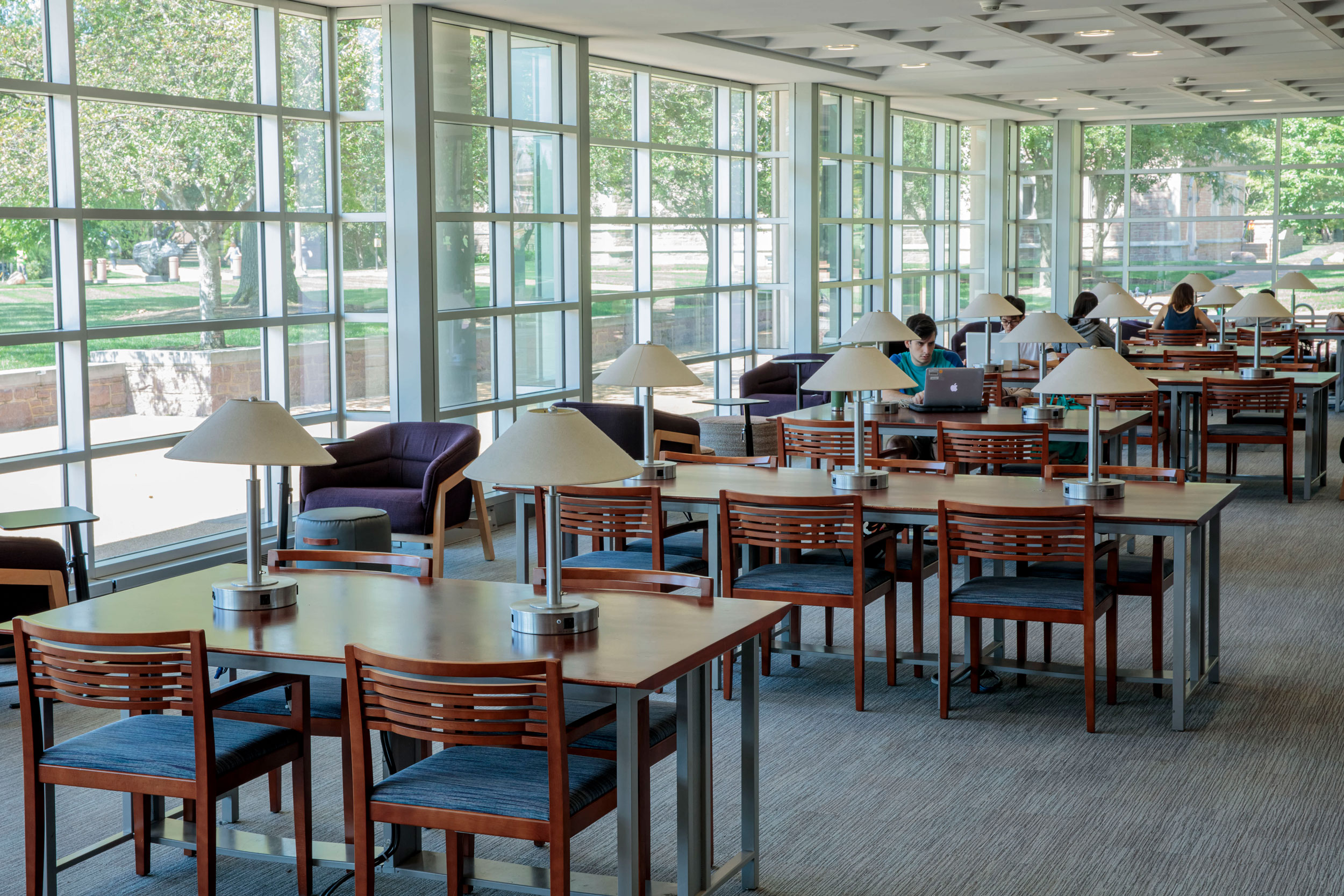 Photo of students using the study tables in Olin Library