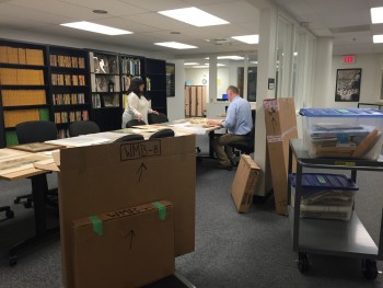 Two staff members sorting through the Baumhofer Collection shipment.