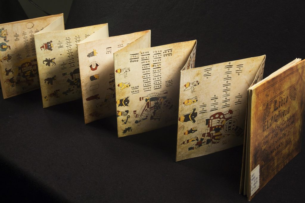 The replica is a folded book with drawings on both sides and the ends posted with tougher book covers.