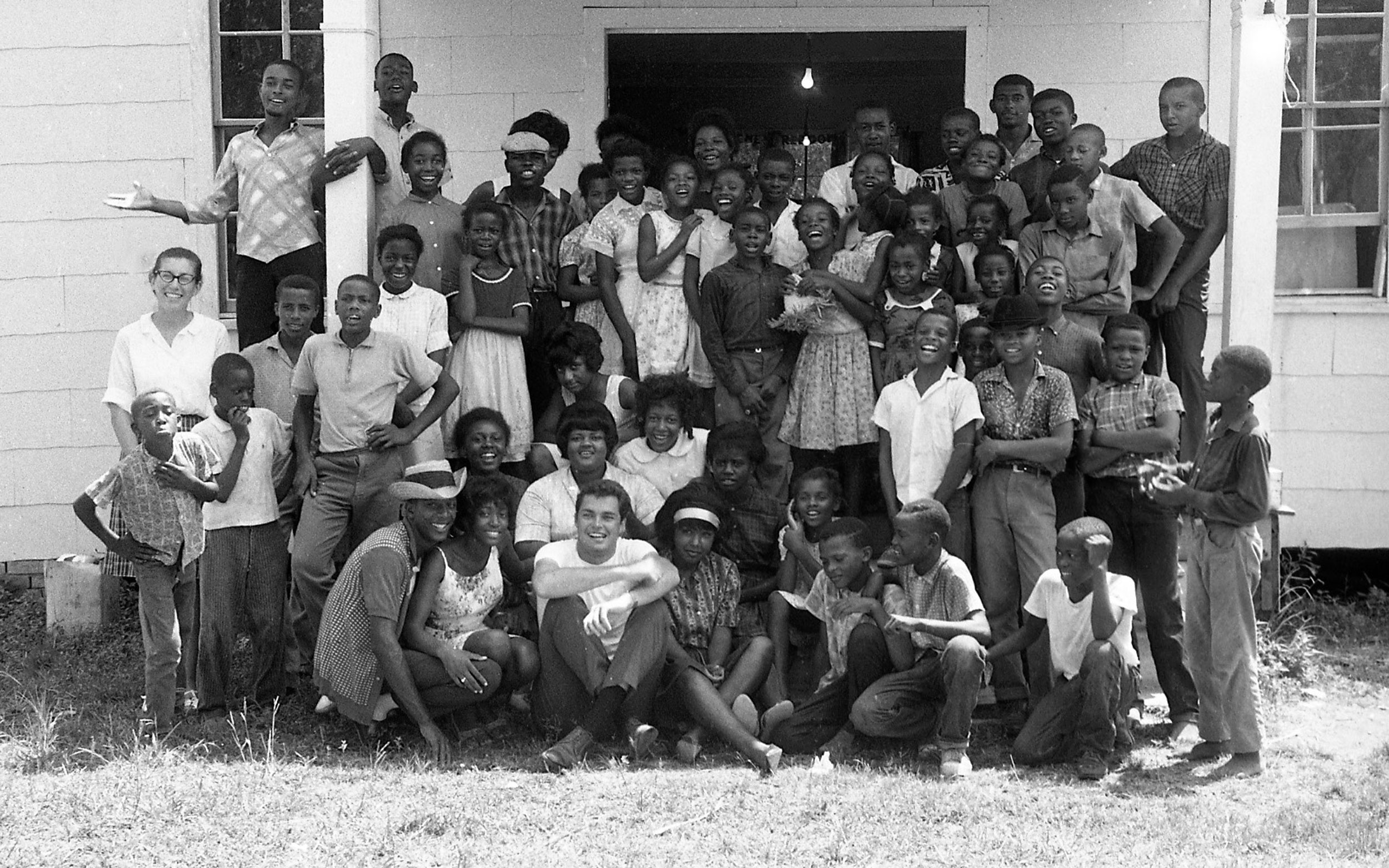Group photo of students and volunteers with Richard Beymer at a Freedom School during Freedom Summer, Mississippi, 1964