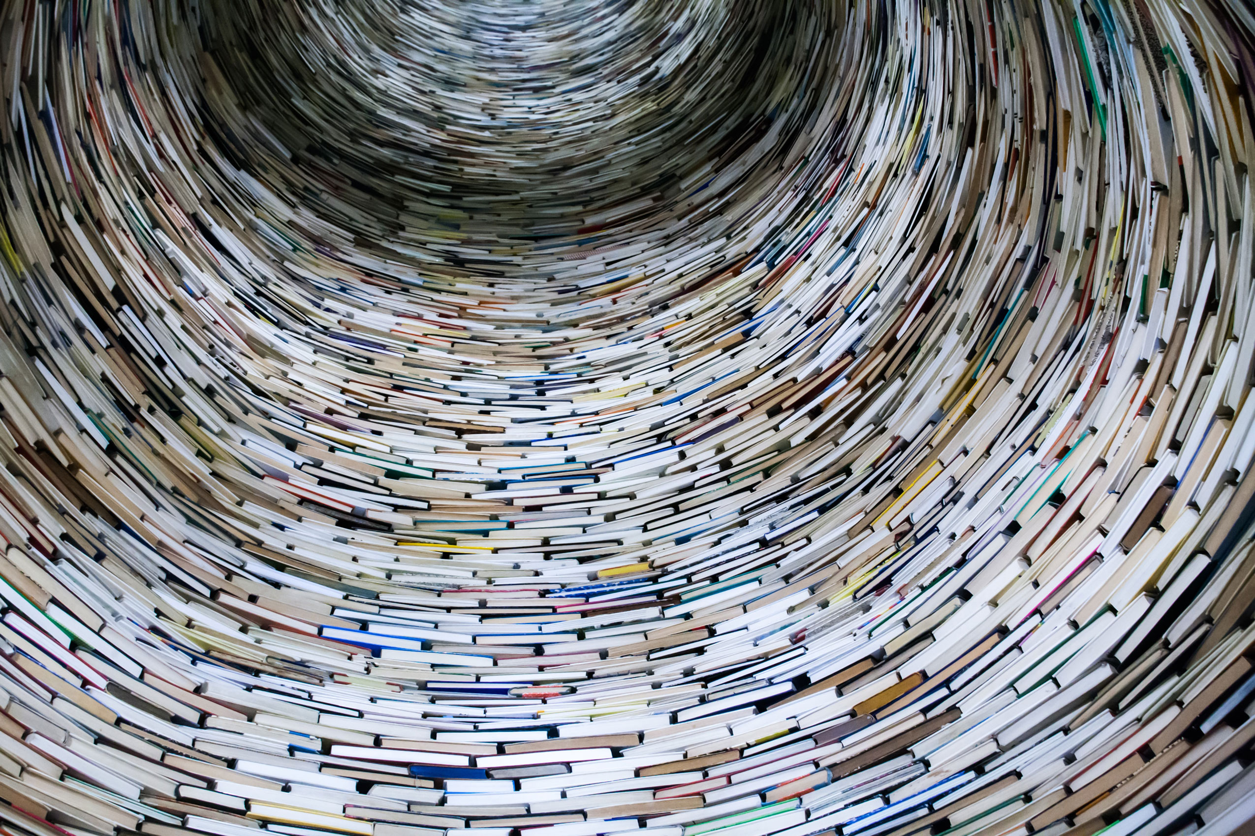 Books swirled spine-out in a column.