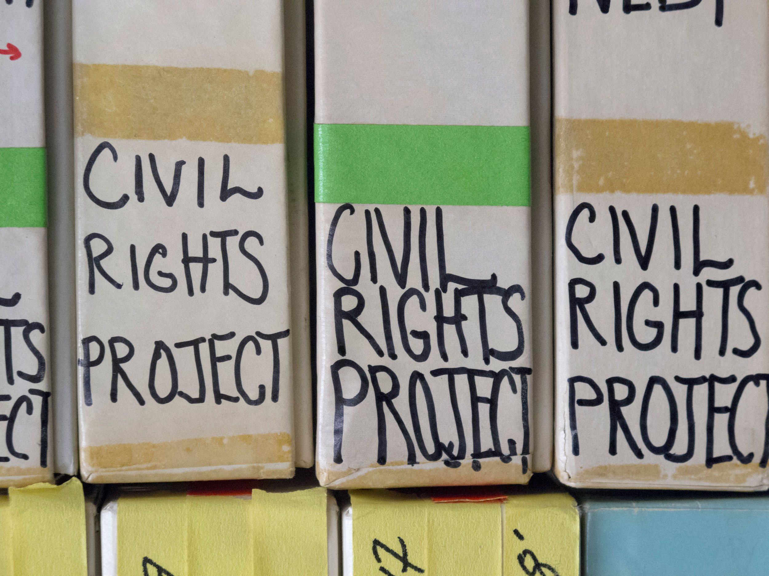"""Close-up on the """"CIVIL RIGHTS PROJECT"""" sticker labels on the film boxes."""