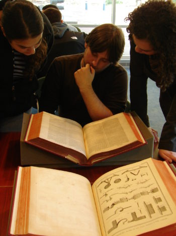 Students viewing the Diderot Encyclopedia in the Special Collections classroom.