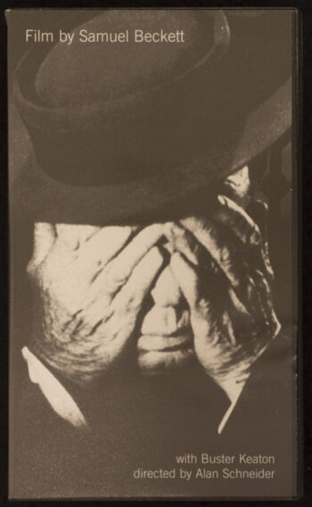 The VHS cover of Film depicts the face of a man in a top hat being covered by his own two hands with is nose and mouth remaining visible.