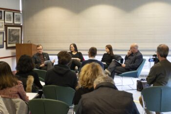 Karlis Verdins, Katja Perat, Xuela Zhang, and Matthias Göritz sitting on a panel discussing Beckett's poetry in front of an audience.