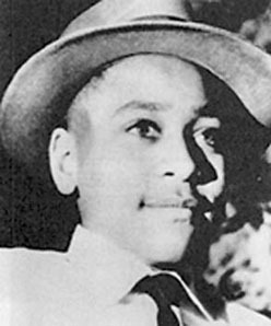 A photo of young Emmett Till in a brimmed hat, collared shirt, and tie taken by his mother in 1954 about eight months before his murder.