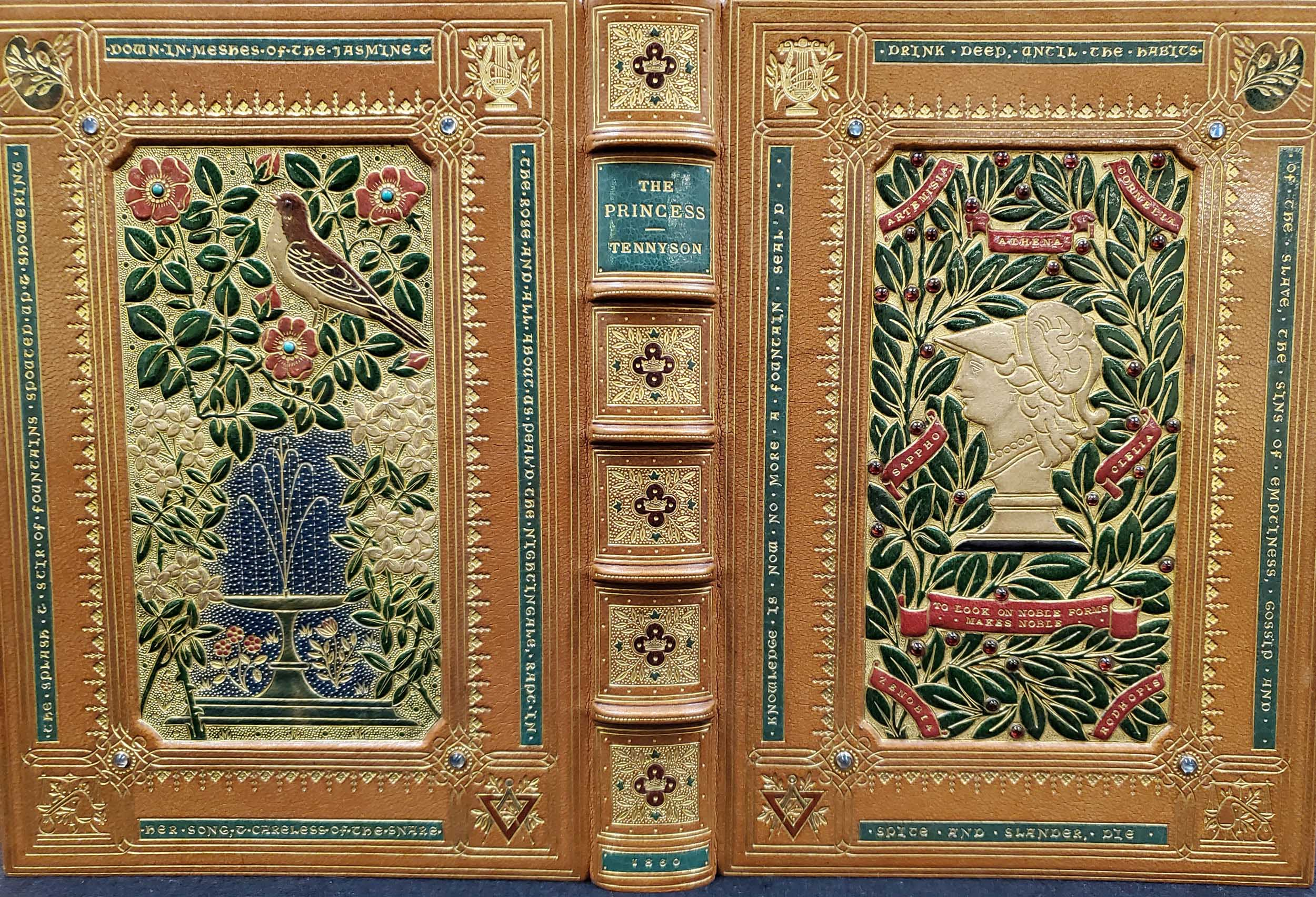 The binding is done in a beautiful, pale leather with colorful decorations stamped into it. The books front cover has a bust stamped into the middle surrounded with lush green olive branches and other decorations in all four corners. The back cover is stamped with a gorgeous fountain surrounded by a bird and two types of flowers alongside it.