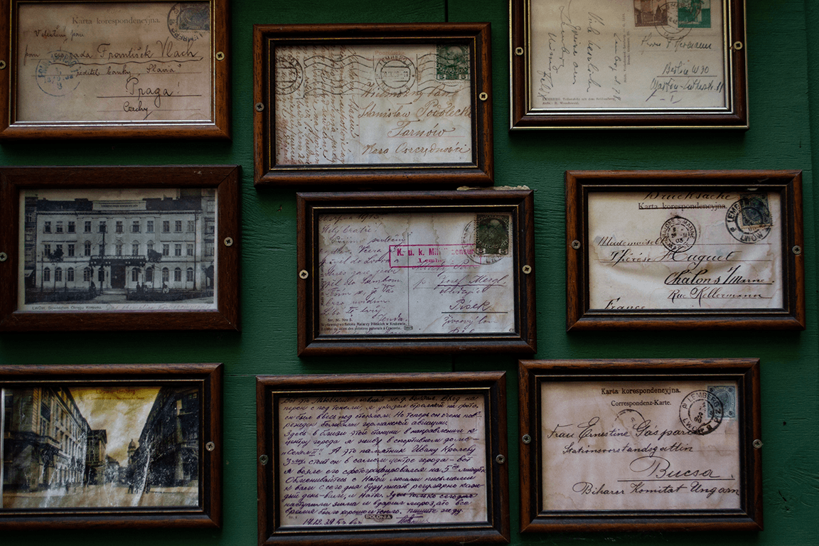 A collage of framed postcards.