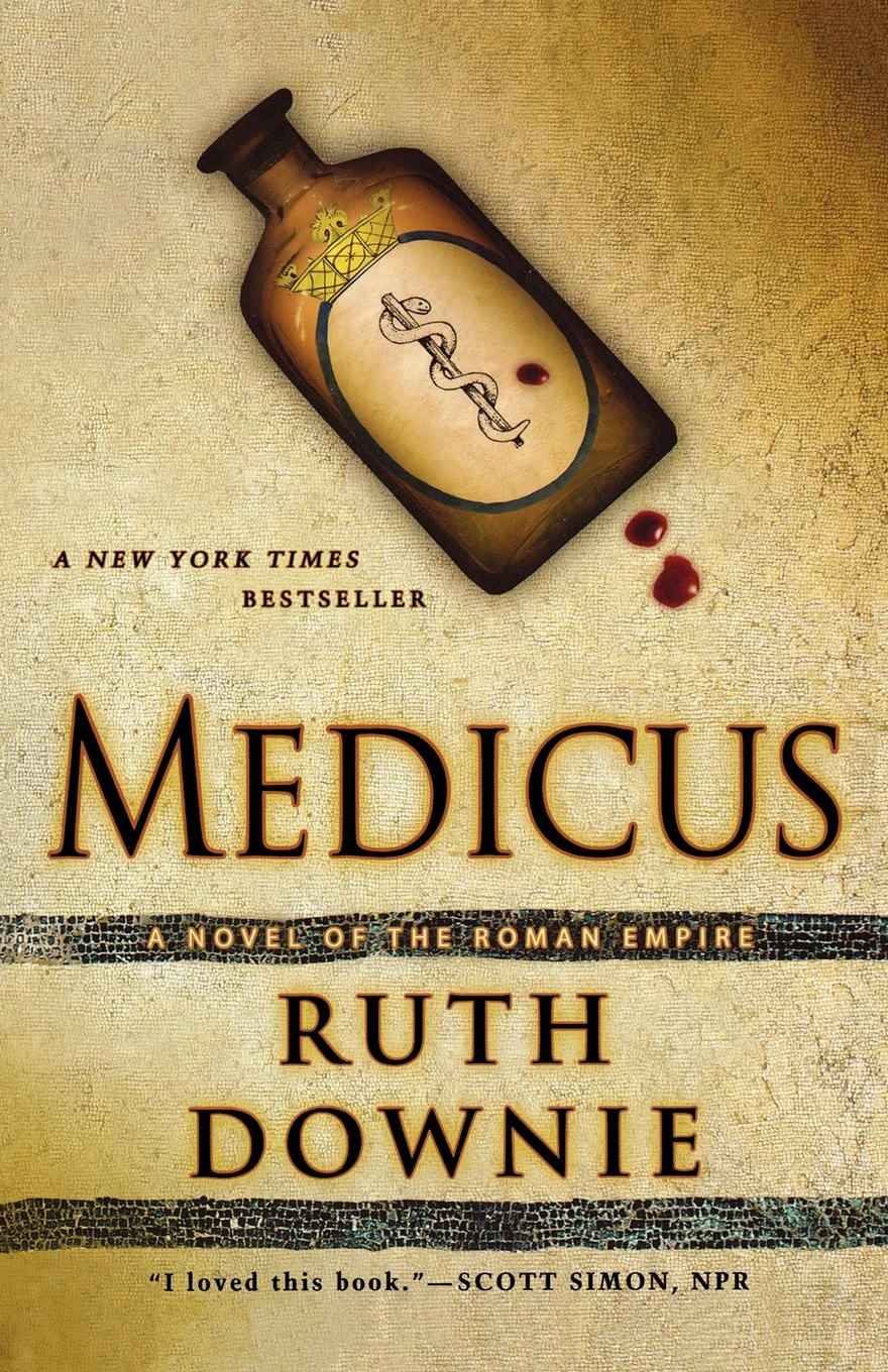 Cover of Ruth Downie's Medicus: A Novel of the Roman Empire. The cover art shows a bottle labeled with a Staff of Aesculapius with three drops of blood.