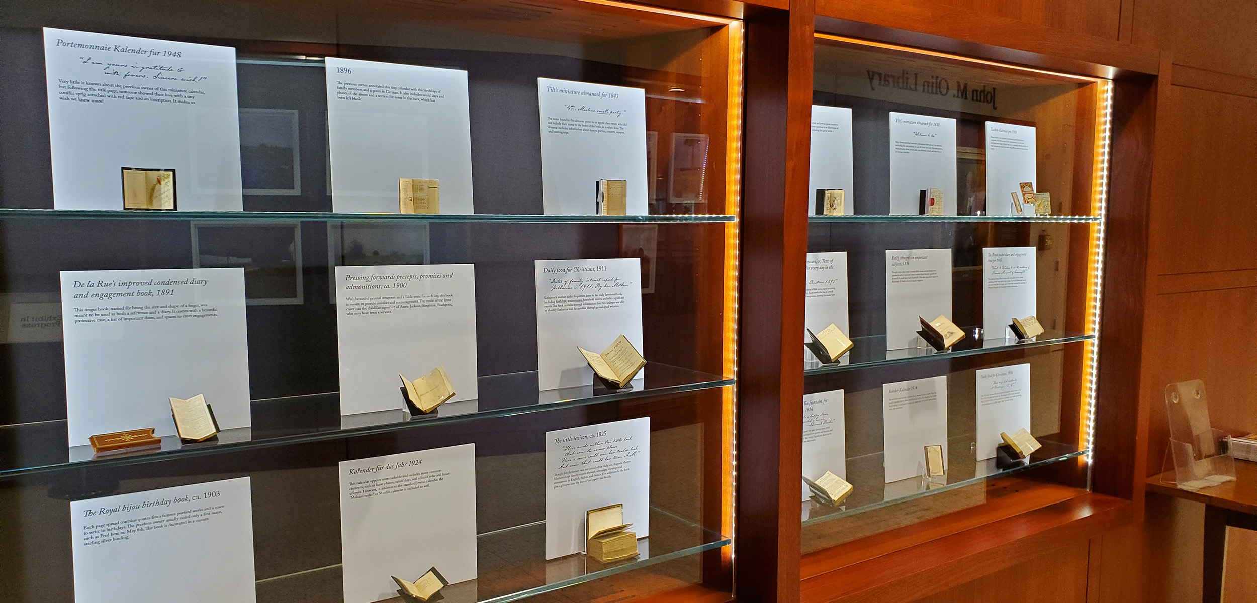 Header image for the A Day in the Life exhibition. The image is of the display case housing the miniature books that are part of the collection on display.