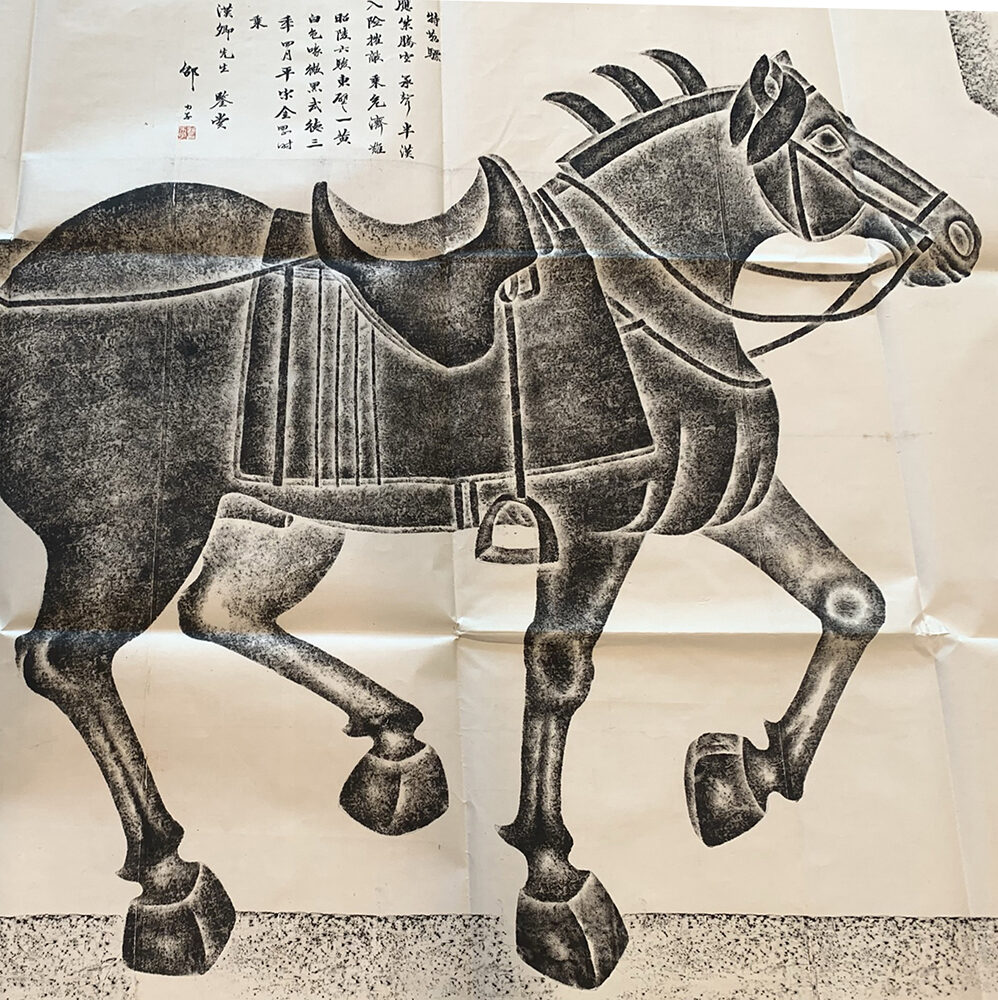 Painted depiction of a Chinese war horse. The painting is in black and white and uses negative space to provide definition to the horse.