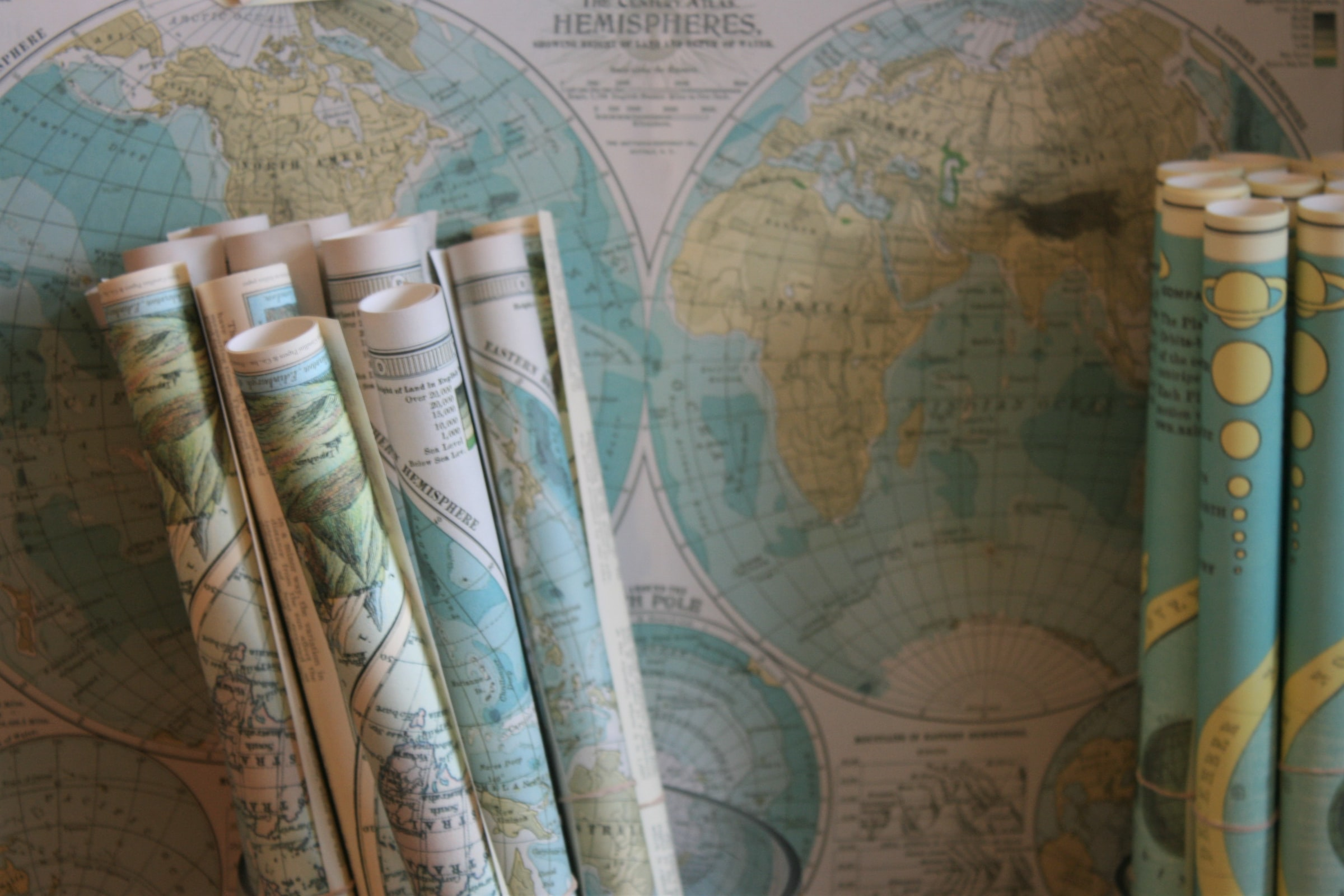 Stock image of rolled and flat maps.