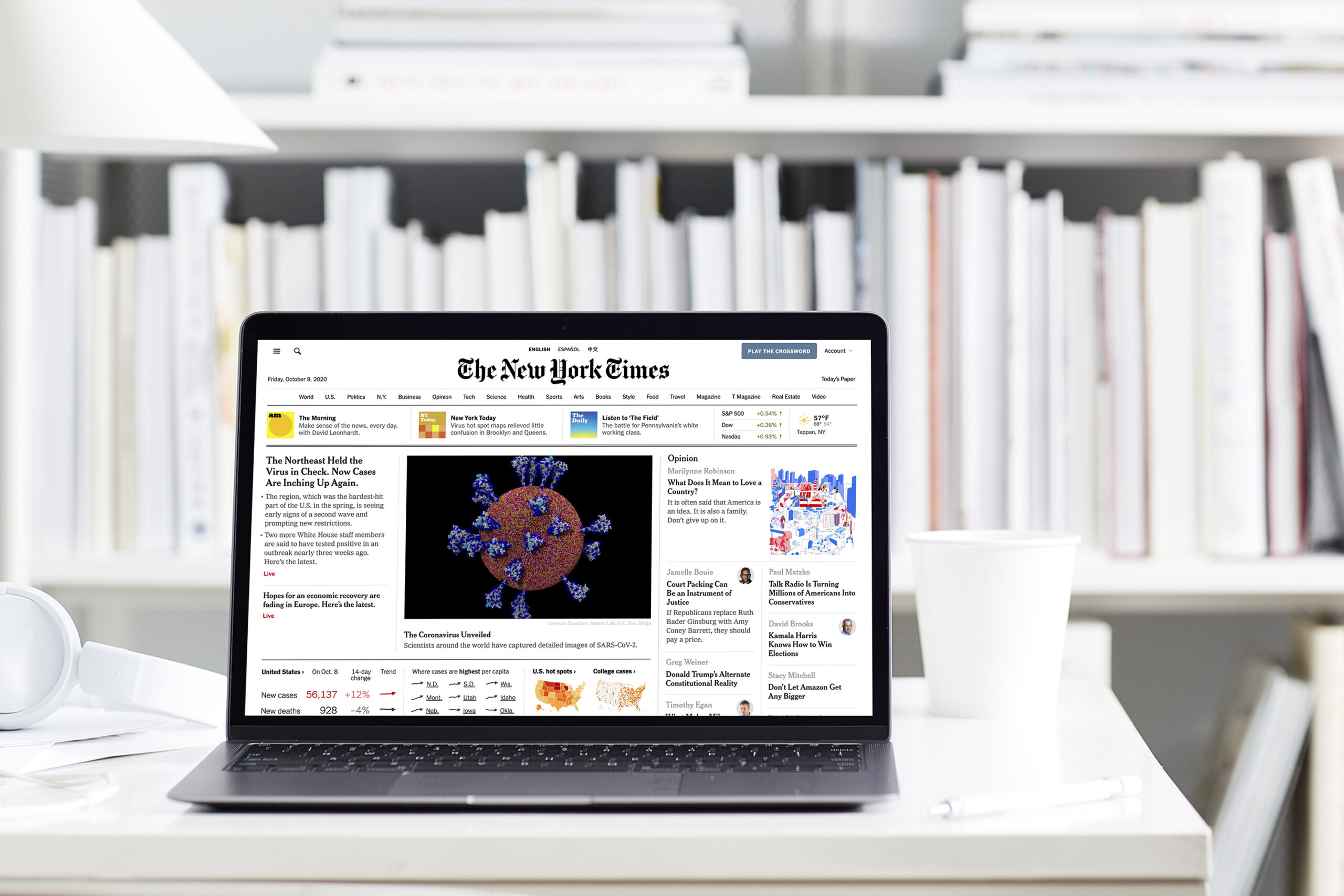The image shows a computer open with the New York Times website pulled up on-screen.